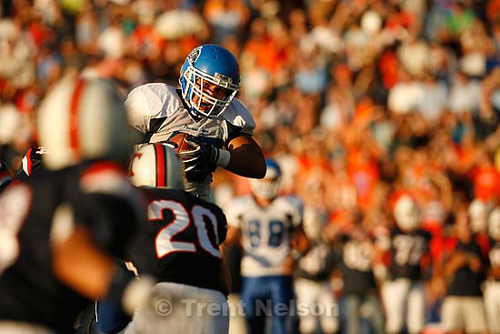 Provo - PG's Sefa Tanoai pulls down a pass. Timpview vs. Pleasant Grove high school football Friday, August 21 2009...