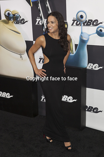 NEW YORK, NY - JULY 9: Michelle Rodriguez attends the 'Turbo' premiere at AMC Loews Lincoln Square on July 9, 2013 in New York City.<br /> Credit: MediaPunch/face to face<br /> - Germany, Austria, Switzerland, Eastern Europe, Australia, UK, USA, Taiwan, Singapore, China, Malaysia, Thailand, Sweden, Estonia, Latvia and Lithuania rights only -