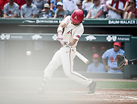 NWA Democrat-Gazette/CHARLIE KAIJO Arkansas Razorbacks infielder Jack Kenley (7) contacts the ball during game two of the College Baseball Super Regional, Sunday, June 9, 2019 at Baum-Walker Stadium in Fayetteville. Ole Miss forces a game three with a 13-5 win over the Razorbacks