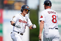 Rochester Red Wings second baseman Tommy Field (59) is congratulated by manager Mike Quade (8) after hitting a home run during a game against the Columbus Clippers on June 16, 2016 at Frontier Field in Rochester, New York.  Rochester defeated Columbus 6-2.  (Mike Janes/Four Seam Images)
