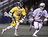 Timmy Ley #21 of Massapequa, left, gets pressured by Matthew Benus #21 of Syosset during the Nassau County varsity boys lacrosse Class A final at Hofstra University on Tuesday, May 31, 2016. Syosset won by a score of 18-12.