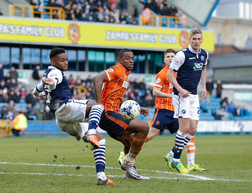 Blackpool's Uche Ikpeazu battles for possession with Millwall's Mahlon Romeo<br /> <br /> Photographer Craig Mercer/CameraSport<br /> <br /> Football - The Football League Sky Bet League One - Millwall v Blackpool - Saturday 5th March 2016 - The Den - Millwall<br /> <br /> &copy; CameraSport - 43 Linden Ave. Countesthorpe. Leicester. England. LE8 5PG - Tel: +44 (0) 116 277 4147 - admin@camerasport.com - www.camerasport.com