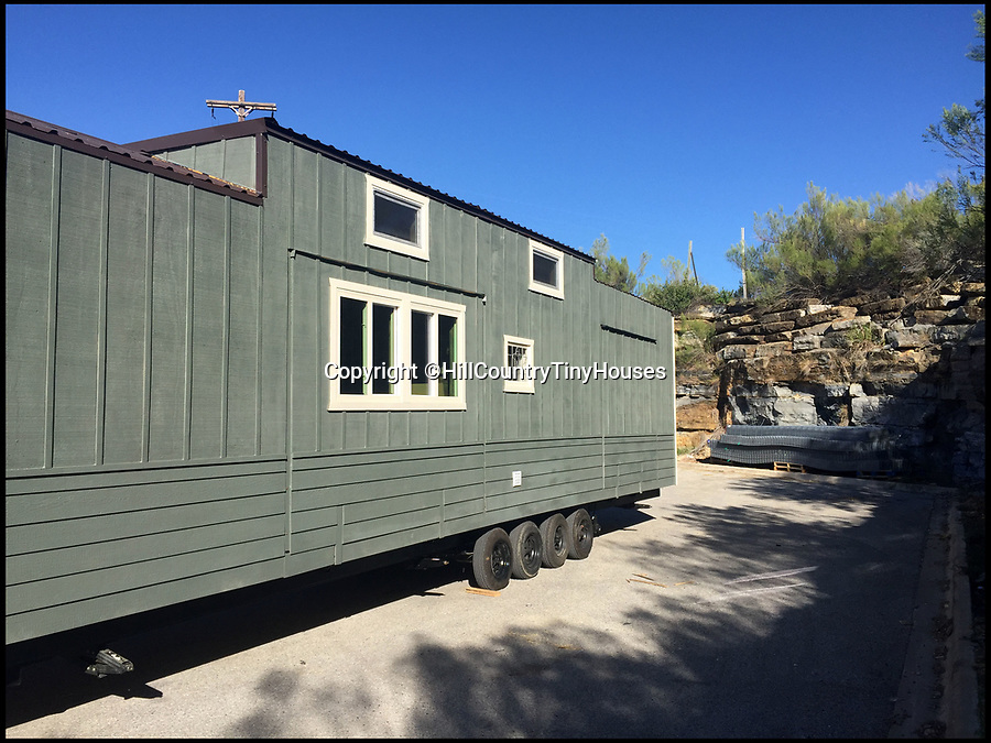 BNPS.co.uk (01202 558833)Pic: HillCountryTinyHouses/BNPS<br /> <br /> Home that Roams - Massive house on wheels you can tow behind you.<br /> <br /> This huge £73,000 house on wheels means you can set up home wherever you want to - without having to give up creature comforts.<br /> <br /> The 40ft custom-made trailer offers 384 sq ft of living space - smaller than the average UK one-bedroom home - but comfortably houses three people and has everything one might need including a dishwasher and a full-size jet spa bath.<br /> <br /> Shari and Todd Snyder had just finished renovating their dream home when they decided to sell their spacious 2,200 sq ft house and create their own tiny house to start a new business, Hill Country Tiny Houses.<br /> <br /> The project took five months with Todd, 49, who has been building and renovating houses for 15 years, custom-making the trailer from scratch and building their home with the couple's son Andrew, 12, this summer.