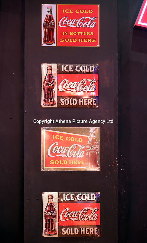 "Pictured: ""Ice Cold Coca Cola Sold Here"" signs on the wall. Monday 15 May 2017<br /> Re: Coyote Ugly Saloon in Cardiff, Wales, UK."