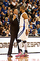 18 February 2012: Greg McDermott head coach of the Creighton Bluejays talks to his player Gregory Echenique #0 of the Creighton Bluejays during the first half against the Long Beach State 49ers at the CenturyLink Center in Omaha, Nebraska. Creighton defeated Long Beach State 81 to 79.