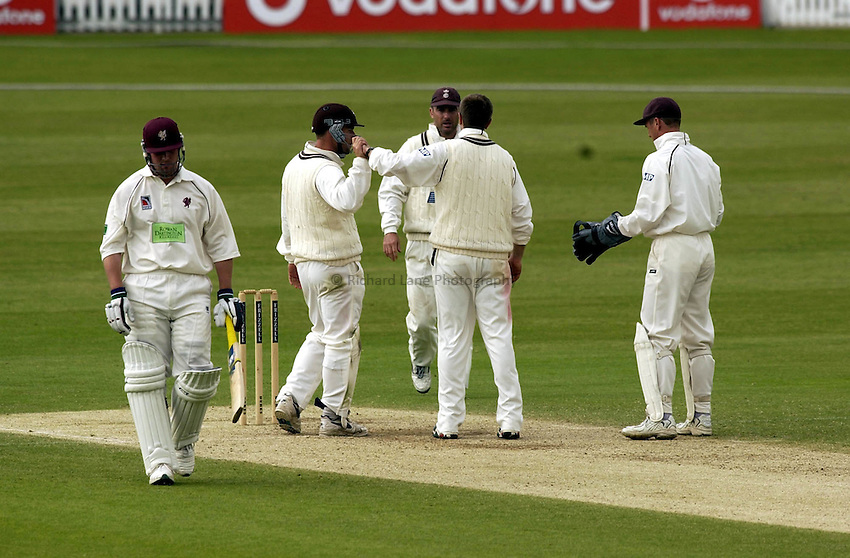 Photo. Chris Young.Surrey vs Somerset.25/5/2002.Somerset's Ian Blackwell trudges off after being trapped lbw by Ian Salisbury on 98.