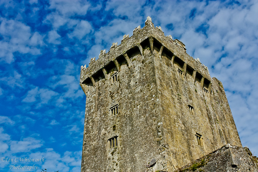 The Blarney Castle stand proud against the beautiful sky.