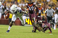 Landover, MD - September 3, 2017: West Virginia Mountaineers wide receiver Gary Jennings (12) breaks a tackle during game between Virginia Tech and WVA at  FedEx Field in Landover, MD.  (Photo by Elliott Brown/Media Images International)