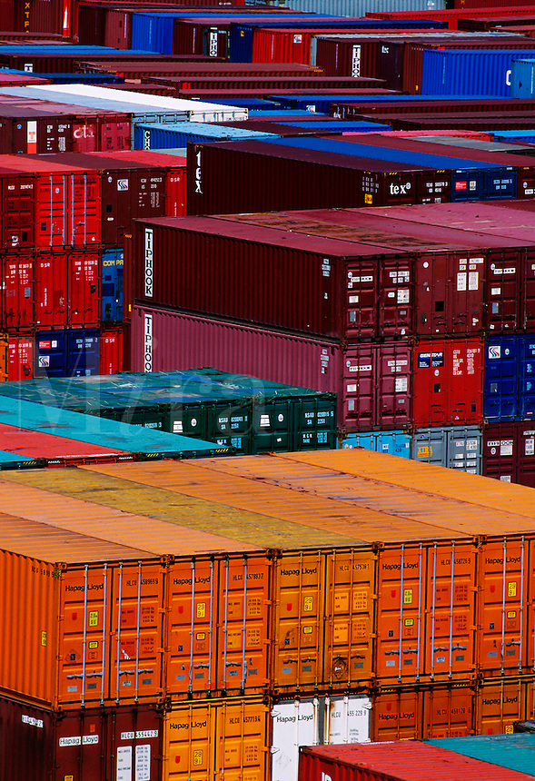 Cargo containers await import and export at dock.