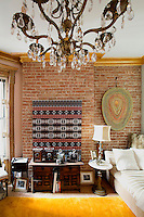 Bright living room with exposed brick wall
