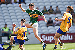 Dylan Geaney of Kerry scores despite Thomas Kelly and Gavin D'Auria of Clare during their Munster Minor football final at Pairc Ui Chaoimh. Photograph by John Kelly.