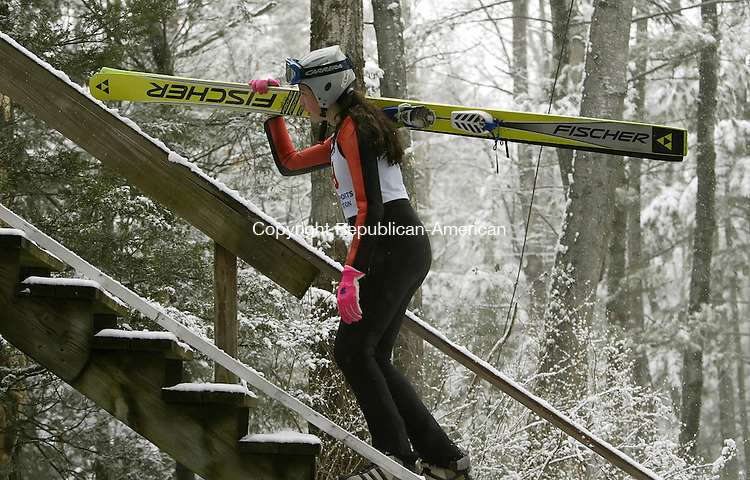 SALISBURY, CT 02/08/08- 020908BZ04- Danielle Lussi, #69, climbs the stairs on her way to the top during the Salisbury Invitational Championship Ski Jump at Satre Hill Saturday afternoon.<br /> Jamison C. Bazinet Republican-American