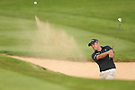 European Ryder Cup captain Paul McGinley splashes out of the sand on the 7th during the second round of the ISPS Handa Wales Open 2013 at the Celtic Manor Resort<br /> <br /> 30.08.13<br /> <br /> ©Steve Pope-Sportingwales