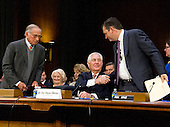 United States Senator Ted Cruz (Republican of Texas), right shakes hands with Rex Wayne Tillerson, former chairman and chief executive officer of ExxonMobil, as he appears before the US Senate Committee on Foreign Relations considering his the nomination to be Secretary of State of the US on Capitol Hill in Washington, DC on Wednesday, January 11, 2017.  Former US Senator Sam Nunn (Democrat of Georgia) looks on from left.<br /> Credit: Ron Sachs / CNP
