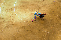 A Spanish bullfighter (matador) fails to kill a bull with the sword at the bullring in Granada, Spain, 7 June 2006.