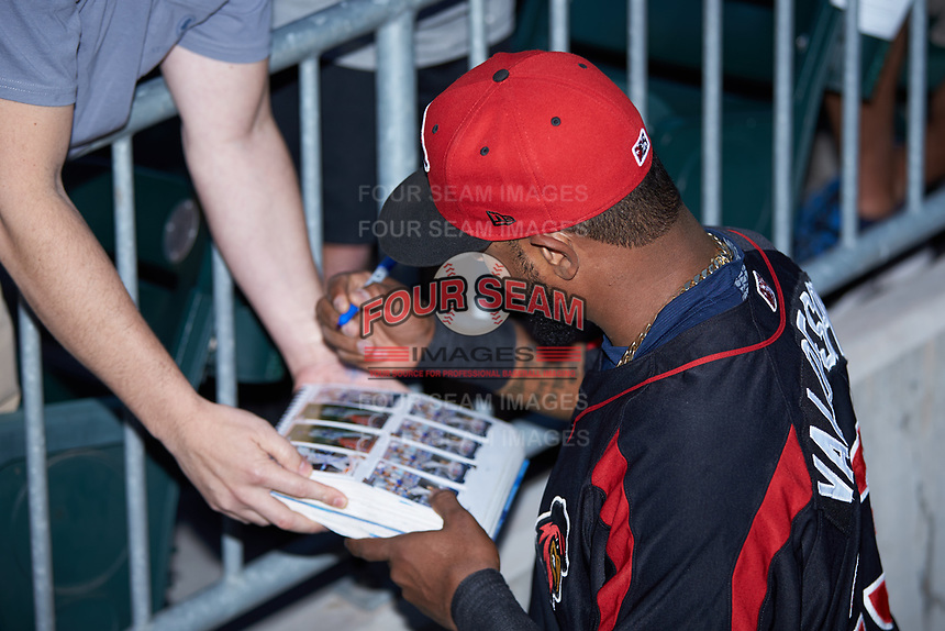 Jordany Valdespin (23) of the Rochester Red Wings autographs baseball cards for a fan prior to the game against the Charlotte Knights at BB&T BallPark on May 14, 2019 in Charlotte, North Carolina. The Knights defeated the Red Wings 13-7. (Brian Westerholt/Four Seam Images)