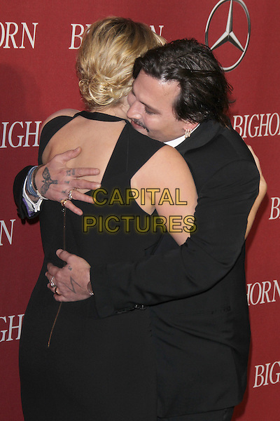 PALM SPRINGS, CA - JANUARY 2: Kate Winslet and Johnny Depp at the 27th Annual Palm Springs International Film Festival Awards Gala at Palm Springs Convention Center on January 2, 2016 in Palm Springs, California. <br /> CAP/MPI24<br /> &copy;MPI24/Capital Pictures
