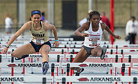 NWA Democrat-Gazette/BEN GOFF @NWABENGOFF<br /> Sasha Wells (left) of Oral Roberts and J'Alyiea Smith of Arkansas run in the women's 100 meter dash Friday, April 12, 2019, at the John McDonnell Invitational at John McDonnell field in Fayetteville.