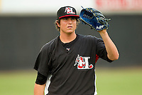 Starting pitcher Luke Jackson #31 of the Hickory Crawdads warms up in the outfield prior to the game against the Lakewood BlueClaws at L.P. Frans Stadium on June 5, 2011 in Hickory, North Carolina.   Photo by Brian Westerholt / Four Seam Images