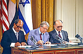 President Anwar Sadat of Egypt, left, United States President Jimmy Carter, center, and Prime Minister Menahem Begin of Israel, right, sign the Camp David Accords at a ceremony in the East Room of the White House in Washington, D.C. on September 17, 1978..Credit: Arnie Sachs / CNP