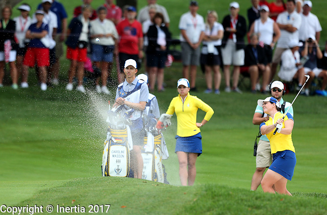 DES MOINES, IA - AUGUST 19: Europe's Caroline Masson blasts out of the sand on the 4th hole during Saturday morning's foursomes match at the 2017 Solheim Cup in Des Moines, IA. (Photo by Dave Eggen/Inertia)