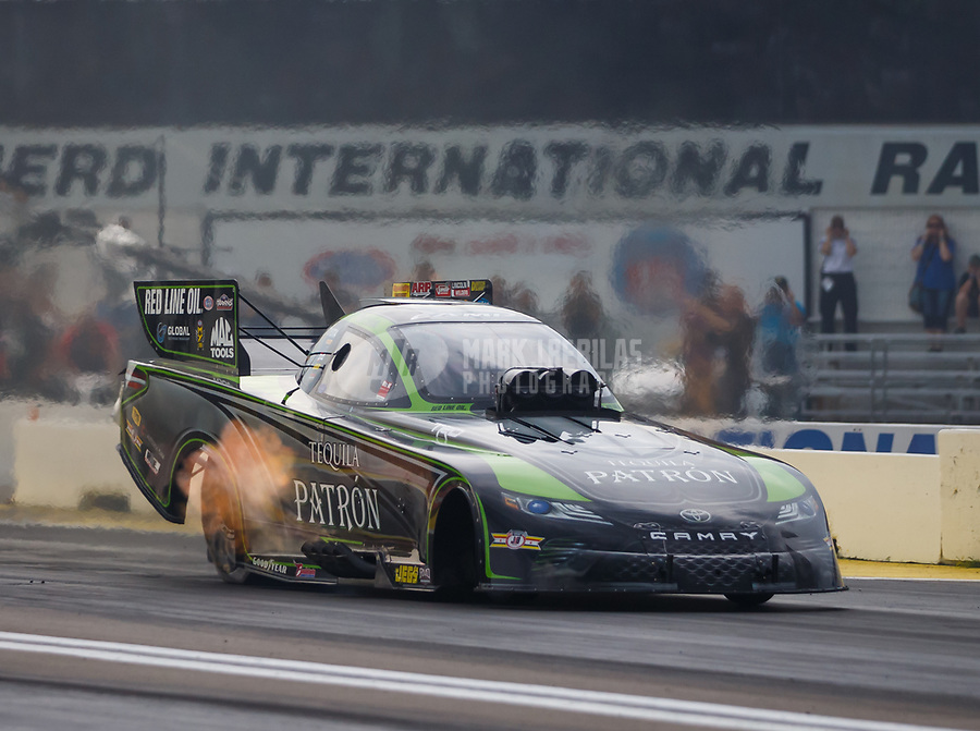 Aug 18, 2017; Brainerd, MN, USA; NHRA funny car driver Alexis DeJoria during qualifying for the Lucas Oil Nationals at Brainerd International Raceway. Mandatory Credit: Mark J. Rebilas-USA TODAY Sports
