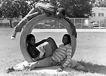 Children hanging out in a school playground in Carle Place, NY on a weekend.