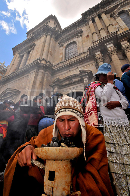 People during the celebration of Alasitas festival in La Paz, Bolivia, where they carry miniature objects of what they would like to achieve during the current year.