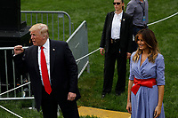 U.S. President Trump and First Lady Melania Trump greet guests at a picnic for military families in Washington, D.C., U.S., on Wednesday, July 4, 2018. Dozens of retired military and national security officers joined the NAACP and the American Medical Association in urging a federal appeals court to uphold a court order blocking Trump's ban on transgender people serving in the military. <br /> CAP/MPI/RS<br /> &copy;RS/MPI/Capital Pictures