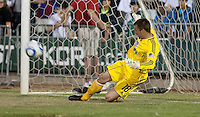 Jon Busch makes a kick save on the shootout. The San Jose Earthquakes defeated Chivas USA 6-5 in shootout after drawing 0-0 in regulation time to win the inagural Sacramento Cup at Raley Field in Sacramento, California on June 12, 2010.