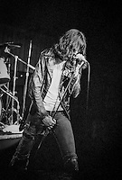 Joey Ramone of the Ramones performing at Ole Man Rivers in September 1982 in New Orleans, Louisiana. USA Camera: Olympus OM2 / Film: Kodak Professional Tri-X 400 Black and White Negative Film