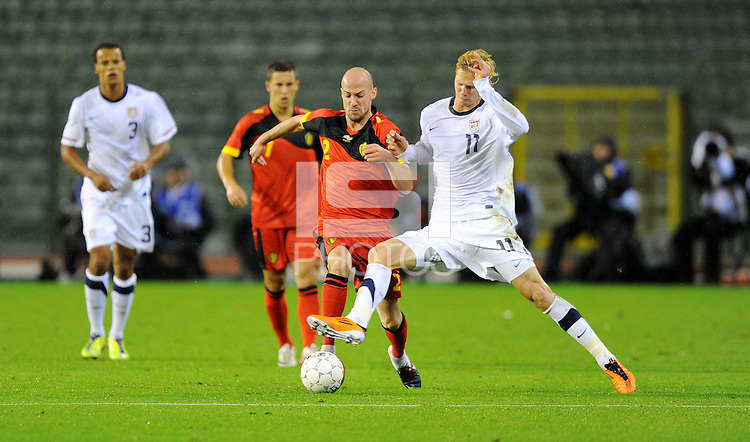 USA's Brek Shea (r) and Belgium's Laurent Ciman fight for the ball during the friendly match Belgium vs USA at King Baudoin stadium in Brussels, Belgium on September 06th, 2011.