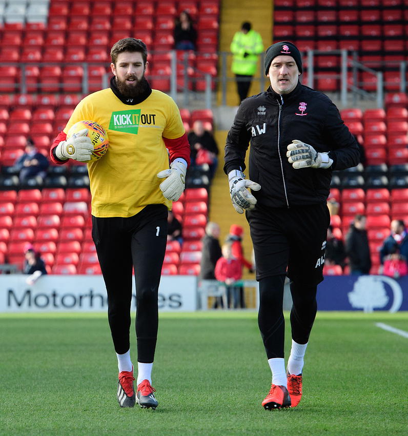 Lincoln City's Josh Vickers and Lincoln City's first team goalkeeping coach Andy Warrington during the pre-match warm-up<br /> <br /> Photographer Chris Vaughan/CameraSport<br /> <br /> The EFL Sky Bet League Two - Lincoln City v Northampton Town - Saturday 9th February 2019 - Sincil Bank - Lincoln<br /> <br /> World Copyright © 2019 CameraSport. All rights reserved. 43 Linden Ave. Countesthorpe. Leicester. England. LE8 5PG - Tel: +44 (0) 116 277 4147 - admin@camerasport.com - www.camerasport.com