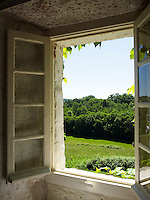 Views of the surrounding French countryside through an open window