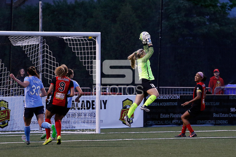 Rochester, NY - Saturday May 21, 2016: Sky Blue FC goalkeeper Caroline Stanley (18) grabs a pass as Western New York Flash forward Jessica McDonald (14) watches. The Western New York Flash defeated Sky Blue FC 5-2 during a regular season National Women's Soccer League (NWSL) match at Sahlen's Stadium.