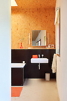 The walls and bath of a second bathroom are clad in Phenolic ply