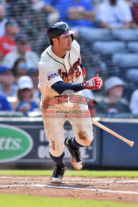 Atlanta Braves shortstop Chase d'Arnaud (23) runs to first during a game against the Chicago Cubs at Turner Field on June 11, 2016 in Atlanta, Georgia. The Cubs defeated the Braves 8-2. (Tony Farlow/Four Seam Images)