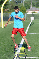 NWA Democrat-Gazette/FLIP PUTTHOFF<br /> FLEET FEET<br /> Cesar Barrientos of Rogers does footwork exercises Thursday August 13 2015 at Veterans Park in Rogers. Barrientos, a martial arts student, was doing conditioning exercises at the multiuse game field.