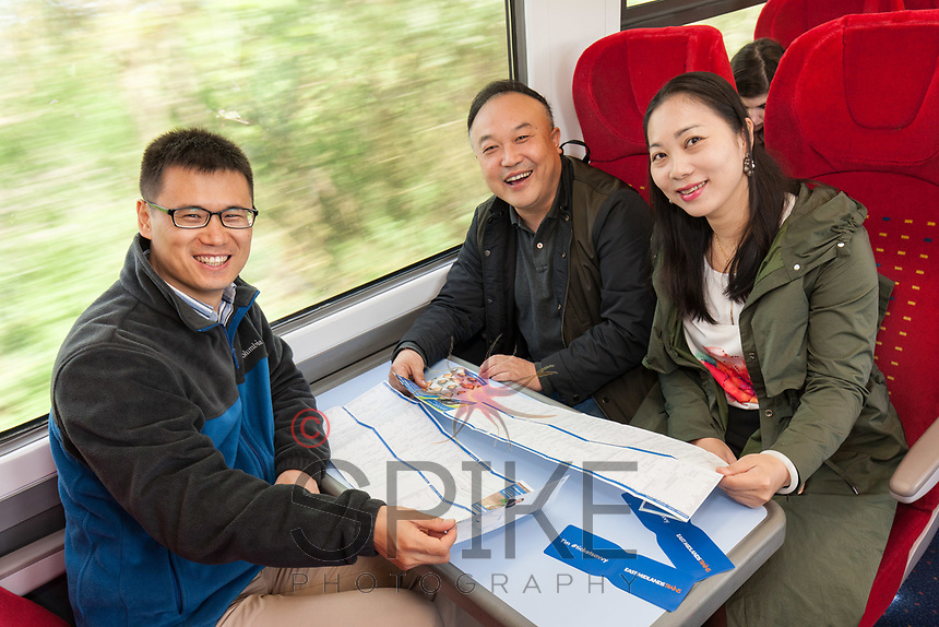 Delighted at the launch of the new Lincoln to Nottingham train timetable are three students from Canton, China, from left Teng Hong Qing, Xu Song Lin and Huang Hui