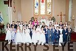 Pupils of t Teresa's NS Kilflynn who made their First Holy Communion on Saturday in St Mary's Church,Kilflynn with the childen were,Tina O'Connor (teacher) Mary O'carroll (principal) and Fr Denis O'Mahony.
