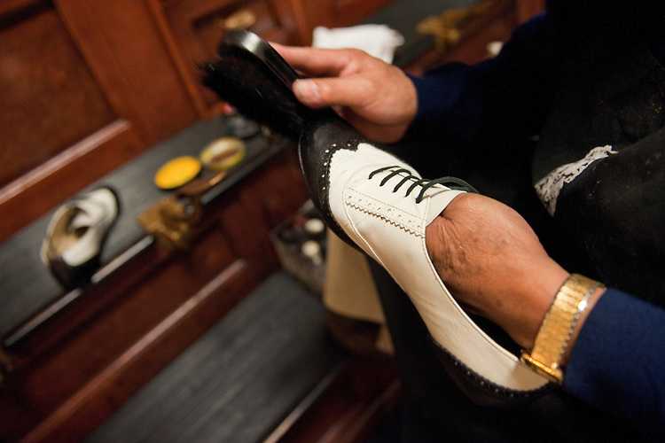 UNITED STATES - AUGUST 26:  Ted Grados polishes shoes in the basement of Cannon Building during the August Congressional recess.  (Photo By Tom Williams/Roll Call)