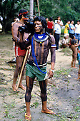 A-Ukre Village, Brazil. Kiabiati (Kim), a young Kayapo Indian warrior and the village's cameraman with video camera; Xingu, Para State.