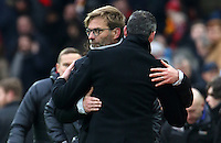 A Liverpool Manager Jürgen Klopp looks dejected as he hugs Swansea City manager Paul Clement after the final whistle of the Premier League match between Liverpool and Swansea City at Anfield, Liverpool, Merseyside, England, UK. Saturday 21 January 2017