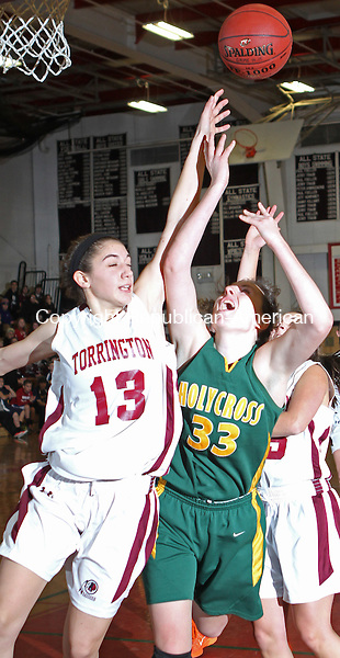 Torrington, CT-19 December 121914MK01 Holy Cross' Caitlyn Cipriano  (#33) draws a foul from Torrington's Brie Pergola (#13)  Friday night at Torrington High School.   Holy Cross defeated Torrington in overtime 69  - 66 . Michael Kabelka / Republican-American