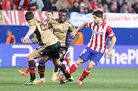 Atletico de Madrid´s Diego (R) and Milan´s Sulley Muntari during 16th Champions League soccer match at Vicente Calderon stadium in Madrid, Spain. March 11, 2014. (ALTERPHOTOS/Victor Blanco)