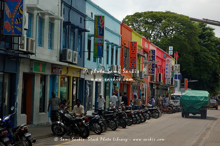 Colorful stores along a busy downtown street, Malé, Maldives.