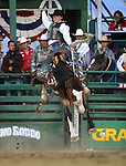 Jake Wright rides in the saddle bronc competition at the Reno Rodeo in Reno, Nev. on Friday, June 19, 2015.<br /> Photo by Cathleen Allison/Nevada Photo Source