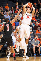 Dec. 22, 2010; Charlottesville, VA, USA; Virginia Cavaliers guard Billy Baron (15) shoots over Seattle Redhawks guard Garrett Lever (1) during the game at the John Paul Jones Arena. Seattle Redhawks won 59-53. Mandatory Credit: Andrew Shurtleff