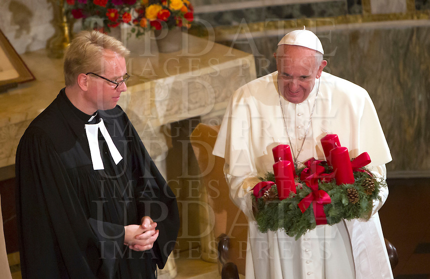 Papa Francesco riceve un regalo dal Pastore Jens-Martin Kruse al termine della sua visita alla Chiesa Evangelica Luterana di Roma, 15 novembre 2015.<br /> Pope Francis receives a chalice by Rev. Jens-Martin Kruse at the end of his visit to the Lutheran Evangelical Church in Rome, 15 November 2015.<br /> UPDATE IMAGES PRESS/Riccardo De Luca<br /> <br /> STRICTLY ONLY FOR EDITORIAL USE