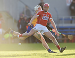 Lorcan Mc Loughlin of Cork  in action against Ryan Taylor of Clare during their Munster Hurling League game at Cusack Park. Photograph by John Kelly.